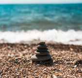 Stack of round smooth stones on a seashore Royalty Free Stock Photography