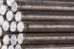 Stack of round steel bar - iron metal rail lines material. Royalty Free Stock Image