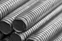 Stack of round steel bar - iron metal rail lines material . Stock Photography