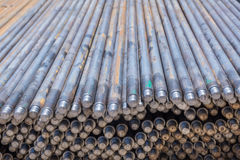 Stack of round steel bar. Material for jack rots in slip form work for industry construction Stock Images