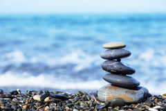 Stack of round stones on the beach Royalty Free Stock Image