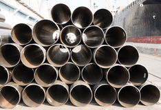 Stack of rounded steel pipes Stock Images