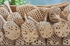 Stack or row of brown round bamboo market in wooden tray. stock photography