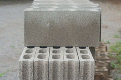 Stack row of gray concrete blocks on ground. Royalty Free Stock Image