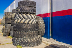 Stack Of Rubber Old Tires Outside Store Royalty Free Stock Images