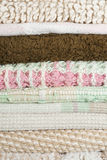 Stack of rugs. Stack of woven fabric throw rugs background texture Royalty Free Stock Photography