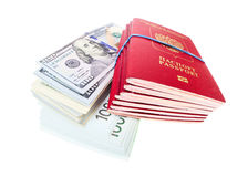 Stack of russian passports and money Royalty Free Stock Image