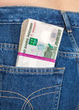 Stack of russian rouble bills in the jeans pocket Stock Images