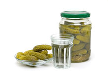Stack of Russian vodka and juicy pickles on a white background Royalty Free Stock Photography