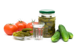 Stack of Russian vodka, tomatoes and cucumbers on a white backgr Stock Image