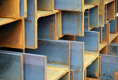 Stack of rusted steel I-Beams. Heavy-duty I-Beams in a stack, diagonal with focus on middle beams stock photo