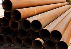 Stack of rusty pipes Stock Images