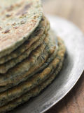 Stack of Sag Roti. Plate with Stack of Sag Roti royalty free stock photos