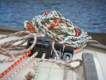 Stack of sail trimming ropes on a sailboat stock images