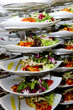 Stack of Salads. Salads are stacked on a cart waiting to be served stock photography