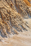 Stack of sand in the form of the foot of the mountain Stock Images