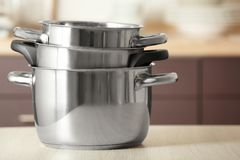 Stack of saucepans. On table Royalty Free Stock Image