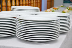 Stack of saucers. The saucers piled ready to serve meals in a gala dinner Stock Photos