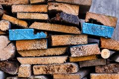 Stack of sawn boards with slices of different shapes. Royalty Free Stock Images