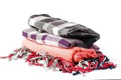 Stack of scarves. Stack of checkered scarves isolated on white background Royalty Free Stock Image