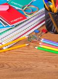 Stack of School Notebooks and Supplies Stock Photo