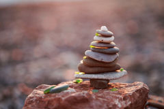 Stack of Sea Pebbles in Shape of Xmas Tree  decorated with colored glass Royalty Free Stock Image
