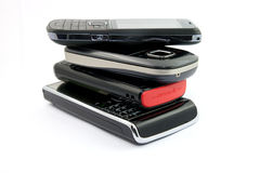 Stack of Several Mobile Phones. Pile of Several Modern Mobile Phones Cell Handheld Units Isolated on White Background stock images