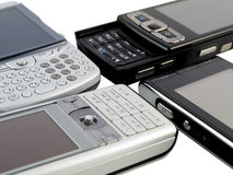 Stack of Several Modern Mobile Phones on White Royalty Free Stock Photos