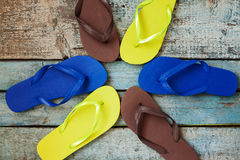 Stack of several pairs of multi-colored rubber flip flops on a b Royalty Free Stock Image