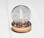 Silver litecoin with bitcoins on white background royalty free stock images