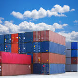 Stack of Shipping Containers. Stacked shipping containers under summer sky with white clouds royalty free stock images