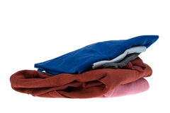 Stack shirts isolated on white Royalty Free Stock Photos
