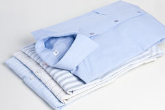 Stack of shirts. On white background Stock Images