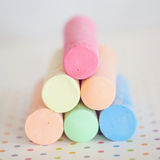 Stack of sidewalk chalk. Closeup of a stack of pastel colored sidewalk chalk Royalty Free Stock Photography