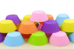 Stack of silicone colorful cupcake molds Royalty Free Stock Photo