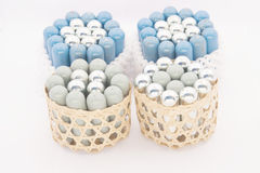 Stack of silver and blue gas container in basket Stock Image