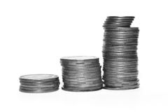 Stack of silver coins isolated on white background, black and white photo Royalty Free Stock Image