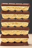 Stack of six black and five white porous chocolate closeup Stock Image