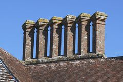 Stack of six brick chimneys Stock Photo