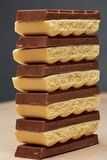 Stack of six dark and five white porous chocolate macro Royalty Free Stock Photography