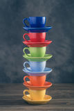 Stack of six multicolored cups on table Royalty Free Stock Photography
