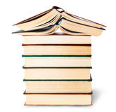 Stack of six old books with two open top Stock Images
