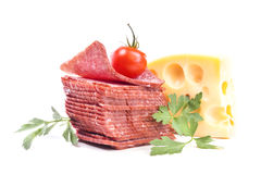 Stack of sliced salami with a piece of Dutch cheese Royalty Free Stock Photo