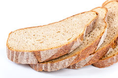 Stack of slices of bread on white background. Stock Images