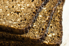 Stack of slices of wholemeal rye bread with seeds, close up Stock Images