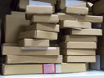 Stack of small cardboard boxes on a shelf Royalty Free Stock Images