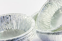 Stack of Small Catering Trays. Closeup - stacks of small round catering trays on a white background Stock Images