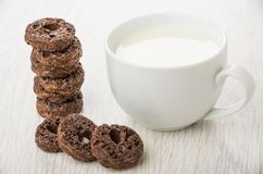 Stack of small chocolate sponges and cup of milk Royalty Free Stock Photo