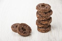 Stack of small chocolate sponges on table Stock Photos