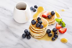 Stack of small pancakes with berries Royalty Free Stock Image